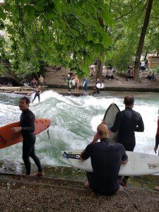 Surfers in Munich English Gardens