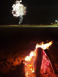 Life goals! Bonfire on the beach. Even better than imagined with fireworks in the background!
